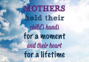 Mothers hold their child's hands…